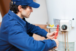 plumber fixing hot water heater
